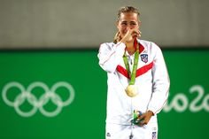 Gold medalist Monica Puig of Puerto Rico reacts during the medal ceremony for Women's Singles on Day 8 of the Rio 2016 Olympic Games at the Olympic Tennis Centre on August 13, 2016 in Rio de Janeiro, Brazil.