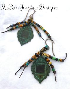 Seed beaded knotted green patina earrings. McKee Jewelry Designs