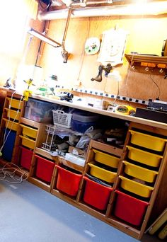workbench-from-ikea-childrens-storage... make a garage or basement work bench from (at least) 2 Ikea Trofast storage units & a slab of cheap but sturdy countertop material
