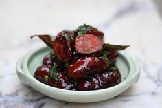 Learn how to make this classic tapas recipe of Chorizo Sausage slowly braised in red wine and honey with Basco Spanish Recipes.