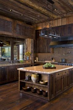 Reclaimed wood and polished mahogany gives the custom Ruby River ranch a sleek and modern look
