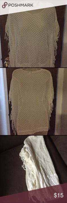 """cb White Lacy Tribal Women's Poncho Sz. S Only worn a few times, tribal lacy loose weave white Poncho looks great with a cami or tank top under it. Length is 25"""". Width is 22"""". It also features white lace on the front. Pet free smoke free home. cb Tops Blouses"""