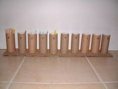 DIY with toilet paper rolls, straws and cardboard. You could pretty it up by using paint or scrapbook paper and using wooden dowels instead.