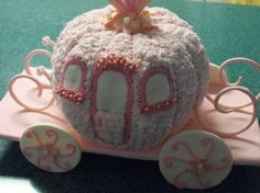 Cinderella Carriage Cake Two bundt cakes Buttercream icing Candies and cookies for decorations
