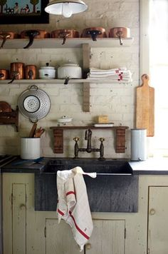 The rustic white brick walls are to die for! Love the open shelving with copper pots. Open shelving puts everything within arms reach. Chippy sage green lower cabinets are a nice contrast. Love the casual rustic feel of this kitchen. Rustic Kitchen, Vintage Kitchen, Kitchen Decor, Kitchen Ideas, Kitchen Country, Kitchen Designs, Open Kitchen, Mini Kitchen, Cozy Kitchen