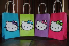 HK handled favor bags or buy your own bags and glue on a print of Kitty's face!.