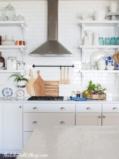 White Kitchen wood range hood, beautiful walnut hood warms up this white cottage kitchen. Kitchen Cabinets Grey And White, White Kitchen Island, White Kitchen Decor, New Kitchen, Kitchen Ideas, Kitchen Walls, Kitchen Wood, Kitchen Curtains, White Cottage Kitchens
