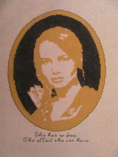 Made this cross stitch of Katniss from Hunger Games. Was really fun to make!