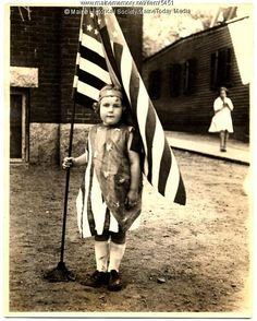 During the 1920s there was great patriotic feeling in the United States.  This child is dressed in a costume representing the American flag. Item # 5451 on Maine Memory Network