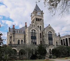 2-12-16 The Victoria County Courthouse in Victoria, TX.  The limestone structure in Romanesque Revival style was completed in just ten months in 1892.  Try that in this day and age.  Of note is the fact that public sentiment saved the building from demolition in the 60's.  Instead, a modern courthouse was constructed on its north side.  Kudos to the citizens of Victoria.