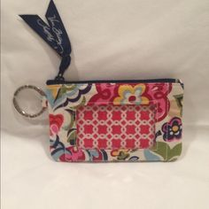 Vera Bradley Coin Purse Preloved Like New Vera Bradley Coin Purse in Hope Garden design. Very Pretty Print in one of Vera's retired designs. Zip closure with an attached ring for keys. See-through pocket on front for driver's license or photo. Your new coin purse will be packed in pretty tissue and immediately shipped. Happy Poshing! Vera Bradley Bags Wallets Driver's License, Vera Bradley, Garden Design, Keys, Wallets, Coin Purse, Closure, Pocket, Zip