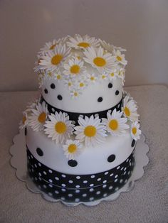 Daisys are gum paste with MMF centers. Cake is covered in MMF. It is white cake with a raspberry cream filling.