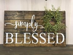 Simply Blessed sign reminds us how blessed we are each and every day. Dimensions are approximately This sign is stained with dark walnut stain and painted with white letters. It has a light green baby peppergrass wreath on it. Its made of wood slats
