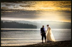 backs of bride and groom walking in the water at sunset (Kristen Borelli Photography, Quadra Island Wedding Photography, Vancouver Island Wedding Photography, Parksville Wedding Photography, Wedding Photography in Victoria, Victoria Wedding Photographer, Nanaimo Wedding Photographer, Nanaimo Wedding Photography, Destination Wedding Photography, Destination Wedding Photographer)