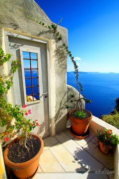 Secret Courtyard in Santorini, Greece This was one of the best islands in Greece 15 years ago. Now it is very touristie