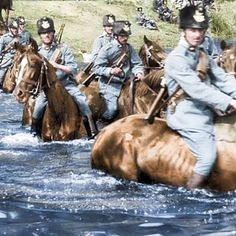 Cavalry units of the Austro-Hungarian army wade through the Isonzo River en route to the Italian border which the Empire shared with their new Southern European enemy who'd just entered the Great War on the side of the Allies. 1915.
