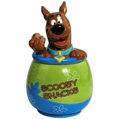 """Westland Giftware Scooby Snacks Cookie Jar by Westberry Wellness Programs. $49.46. Bright and cheery. Fun characters. Exceptional quality. Made of ceramic material. Wonderful Gift. This fun, brightly colored Cookie Jar features Scooby from Scooby Doo, and says """"Scooby Snacks"""" written across the front. Westland Giftware is known for quality and design."""