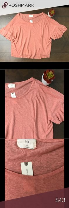 "Anthropologie t.la Ruffle Sleeve Hemp Top Anthropologie t.la ruffle hem sleeve top. Size large. NWT, no flaws. 46"" chest, 22"" in length. Oversized fit. Made of hemp and organic cotton. Salmon in color. Anthropologie Tops Blouses"