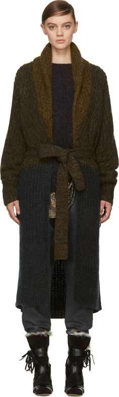 Long sleeve marled wool knit coat in olive and navy. Flecks of red and yellow throughout. Shawl collar. Self-tie belt at waist. Patch pockets at hips. Tonal stitching.<br><br>Please note that this product can only be shipped within North America.<br><br>