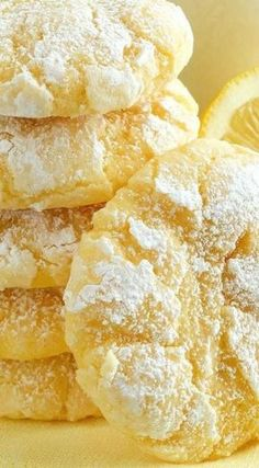 Lemon Gooey Butter Cookies ~ Deliciousness made with all-natural flavoring - triple lemon! Melt-in-your-mouth Lemon Gooey Butter Cookies at their finest and from scratch. Buttery, light and tender-crumbed, sweetened just right and bursting with lemon flav Gooey Butter Cookies, Lemon Sugar Cookies, Yummy Cookies, Lemon Cookie Recipe, Lemon Crinkle Cookies, Lemon Cookies Easy, Almond Joy Cookies, Cream Cheese Lemon Cookies, Lemon Cake Mix Cookies