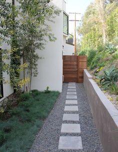 Modern Landscape Gates Design and gravel walkway for the side yard
