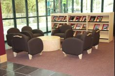 Worden Express lounge chairs and 400 Series drum table. ==Library Interior Designs== library furniture distributors,library furniture,school library furniture,library bookcase design,library inter...