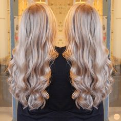 Soft warm blonde with wavy long hair