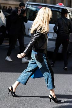 A leather jacket is paired with cropped jeans and slingback pumps
