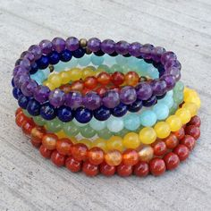 Bright and Happy set of gemstone bracelets! One for each chakra! Amethyst, lapis lazuli, amazonite, aventurine, yellow jade, carnelian, and red jasper!
