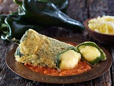 Recipe for Chile Rellenos   Save on this recipe! Take the Queso IQ Challenge and claim your coupon for new Cacique Shredded Cheese.