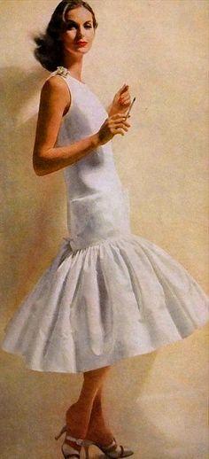 1956 Anne St. Marie in white piqué sheath ending in a Flamenco flounce by Traina-Norell