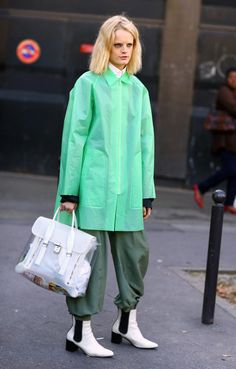 Green plastic raincoat, fisherman pants via Street Pepper