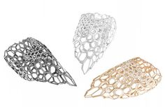 Zaha Hadid creates rings from gold lattices for Caspita