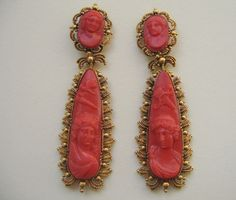 Amor & Psyché earrings - pair of 15 carat gold & coral (day and night) earrings. The two detachable parts have large coral cameos in the shape of a drop. They depict a man (long hear and a small butterfly carrying the fire of love) and a lady (hair up and Amor's bow and arrow) looking at each other. The smaller oval top parts decorated by two smaller cameos also with a man and a lady. All cameos have an entourage of beautiful gold wirework (cannetille), England with Italian cameos, circa...