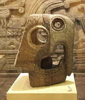 Images from the National Museum of Anthropology--  Head of guacamaya (macaw) from Xochicalco  Late Classic. Height: 55cm The people in this area worshiped this bird as a form of the sun.It is thought that this stone object was used as a score marker in the ball games toltecs