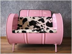 5 Awesome Ideas to Repurpose Metal Barrels    I love the Pink and Black & White cow print