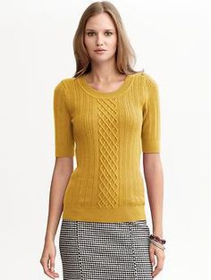 Apparently a yellow sweater with a black-and-white skirt is the look these days -- Banana Republic