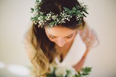 """The bride made her own floral crown with floral wire, fresh greenery and baby's breath while she and her bridesmaids were getting ready. """"It was super easy to make, and only took about 20 minutes!"""" Dana says."""