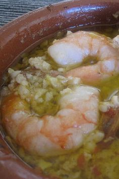 Gambas al Ajillo.  Delicious!  Next time I will use either a little less chili flakes or (preferably) part of a dried chili.  Otherwise this was amazing.  The oil left in the cazuela is wonderful to dip crusty bread in.  I can't wait to try again.