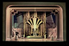 Anything Goes, which earned McLane a Tony Award nomination for Best Scenic Design of a Musical, McLane consulted books on luxury ocean liners, on Hollywood in the 20s and 30s, and on Art Deco. He points to the cover of a book called Art Deco in North America by Eva Weber, which features a wooden China Cabinet.
