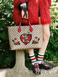 Discover more gifts from the Gucci Garden. The embroidered limited edition GG motif tote with red leather accents by Alessandro Michele.