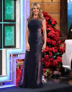 JOVANI Navy blue jersey gown w/navy illusion shoulders & sides enhanced with sequins & beads, scoop neckline, cap sleeves, flared hemline w/train | Vanna White's dresses | Wheel of Fortune