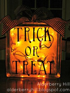 Halloween Glass Blocks with Lights - use vinyl adhesive letters or rub on letters on glass block, add lights & ribbon ~ Alderberry Hill