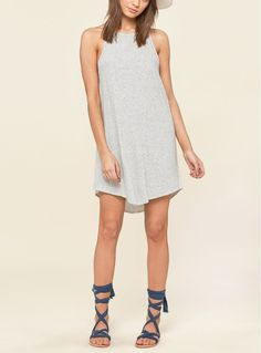 Heather-grey stripes pattern this simply cut tank dress knit in a supersoft blend of cotton and modal.