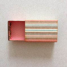 And now the matchbox has been lined with pattern papers... You can slide in the drawer to the cover...