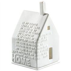 Lyshus til fyrfadslys - Home til en svævehylde sammen med Welcome skilt