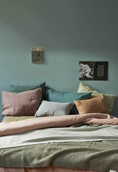 serene blue green bedroom with dusty rose accents | tonal bedlinen in blue and green | minimal yet colourful bedroom | Get the look with an olive Bemz bedspread