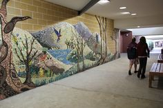 Artist in residence Lily Dale High. Part of the walk way mosaic depicting regeneration after the fires affected members of the school community.