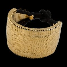 Presenting a showstopping vintage original silver tribal cuff restrung with black cotton and dipped in 22ct gold. The workmanship and methods employed to produce these masterpieces are unique to a handful of highly talented jewellers in Bihar and are no longer made. A classic item that you will love for ever.   | 22Ct Gold Dipped Silver Bracelet |  Bihar |  India |  Circa Mid 20th Century |  Wrist Dia 5.5cm |  Width 4.5cm |  108g |  £380. www.rabari.co.uk
