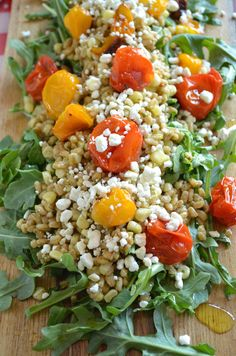 farro salad with fresh corn, roasted tomatoes, and lemony basil pesto over arugula and topped with goat cheese! #farro #salad #corn #tomatoes #goatcheese #summer #salad